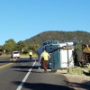 Driver Arrested After Truck Towing Hay Overturns