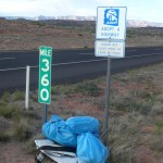 Arizona highway blue bags filled with litter