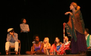 """Photo 1 by Jenifer Gill - suggested caption: VVS students Nadir Yondu from Istanbul, Turkey; Jennie Harlan from Sedona; Lola Olorode from Nigeria; Tatiana Krakhamaleva from Moscow, Russia; Rachel Harper from Ras Tanura, Saudi Arabia; teacher Claire Brislin; and Jess Harmon from Flagstaff rehearse """"The Tsar's Favorite Circus"""" to be performed this weekend."""